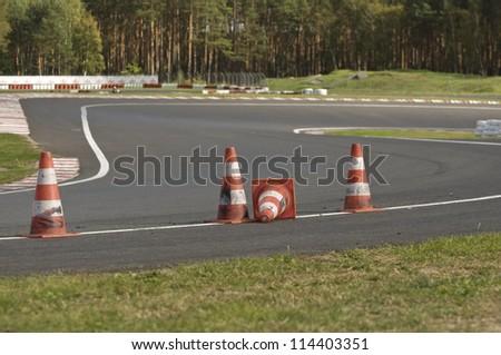 orange striped cones on the motorbike track, motoGP