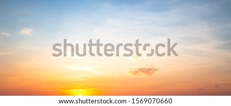 Orange summer morning sky and clouds background
