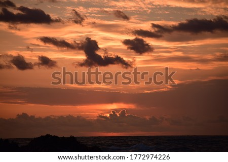 Orange sun setting with a cloudy sky. Photo stock ©