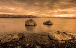 Orange Sunrise over Lake Pukaki with Mount Cook in the background