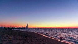 Orange sunset at the beach in Dubai Kite Beach
