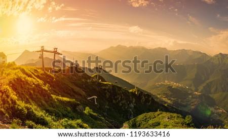 Orange sunset in the Caucasus mountains, Rosa Khutor, Sochi, Russia