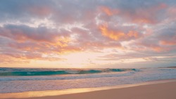 Orange sunset on beach over the sea over Atlantic ocean landscape. Sunny Sandy beach and sky and sea and clouds background. Summer sunny day on the beach. Concept sundown copy space ocean orange sun