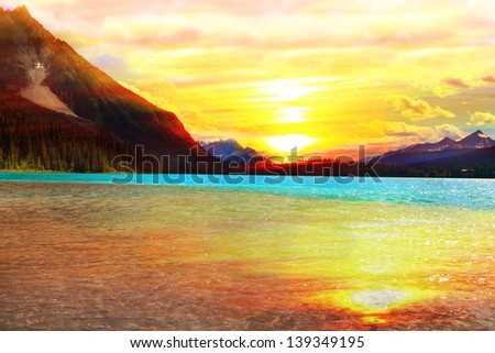 Orange sunset over Emerald lake in Canadian Rocky Mountains (Yoho National park. Alberta. Canada)