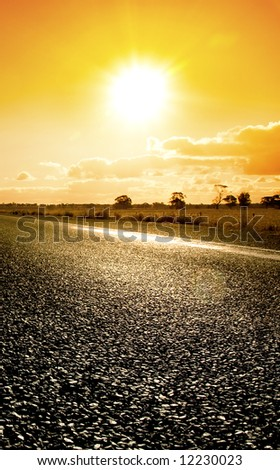 Orange sunset over rural highway