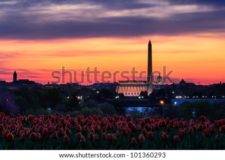Orange sunset over Washington Monument and Lincoln Memorial viewed from Netherlands Carillon, Washington, D.C, U.S.A. - stock photo