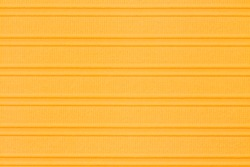 Orange textured cardstock paper closeup background with copy space for message or use as a texture