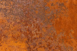Orange textured old rusty metal surface. An weathered oxidized patina with a copper color, texture and structure. Vintage material effect