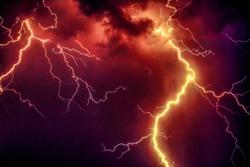 orange thunderstorm night sky