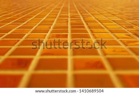 Orange tile pattern, shallow depth, clear depth #1410689504