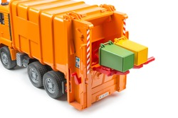 orange toy garbage truck with two garbage containers, isolated object, white background, garbage truck loads containers with garbage