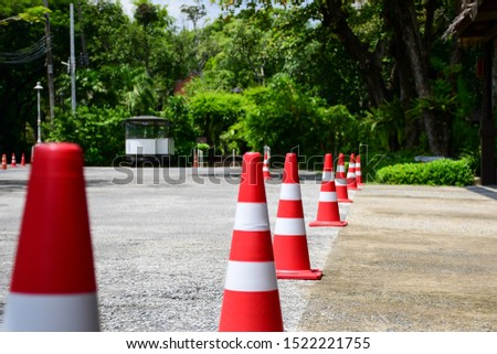 Orange traffic cone are placed to protect the dangers of driving or land traffic to ensure safety.
