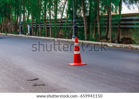 Orange traffic cone on street #659941150