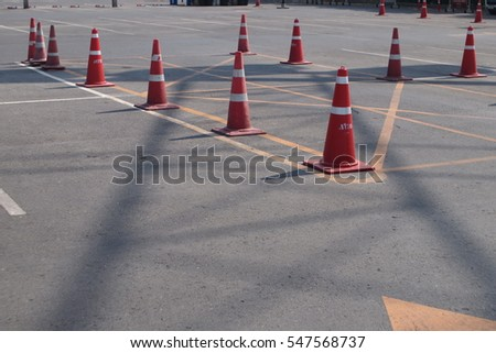 orange traffic cones in outdoor parking lot #547568737