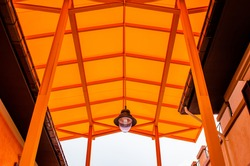Orange translucent roof or orange skylight roof with lamp, Thailand.