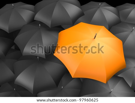 Orange umbrella standing out from background of black umbrellas