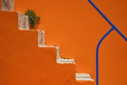 Orange wall and stair