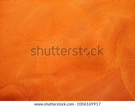 Orange wall with rustic texture made with mortar. #1006169917