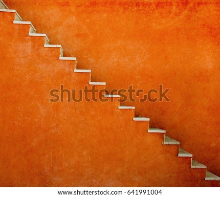 Orange wall with stairs texture background, minimalistic style for base image for posters, banners or covers, trivial design and simplicity is a trendy key for graphic arts, acid psychedelic color