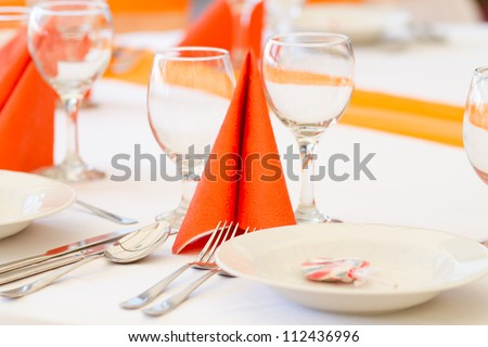 orange wedding table set for fine dining or another catered event