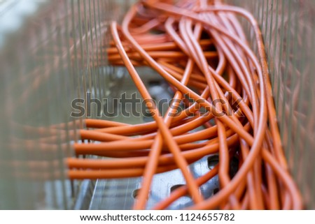 Orange wires in the electrical wiring duct #1124655782