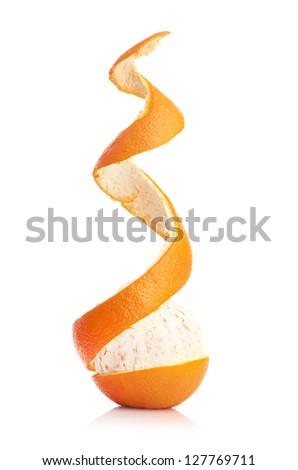 orange with peeled spiral skin isolated on white background