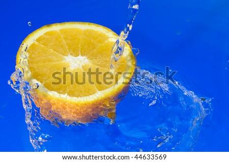 Orange with splashing water. Tropical citrus fruit
