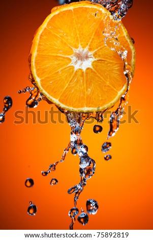 Orange with water splash - stock photo