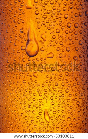 Orange yellow beer droplets, abstract background