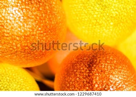 Orange yellow glowing balls. Glowing orange balls. Glowing yellow balls. Glowing Christmas balls #1229687410