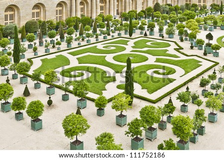 Orangery was designed by Louis Le Vau, it is located south of the Palace Versailles, Paris, France. Versailles was a royal chateau. It was added to the UNESCO list of World Heritage Sites