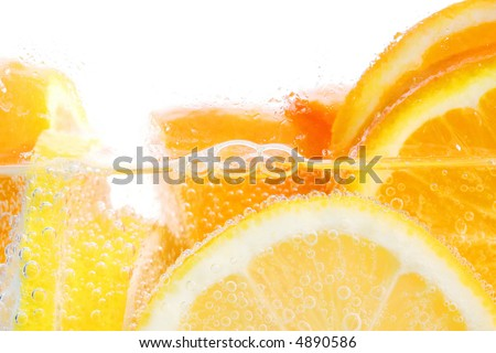 Oranges and lemons in club soda with white background