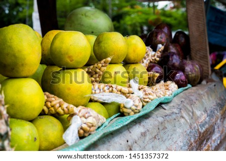 Oranges, Groundnuts and Avocade display at a Market