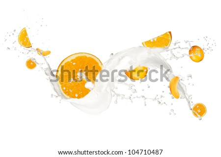Oranges in cream splash, isolated on white background