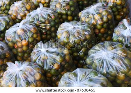 Oranges in plastic bag.