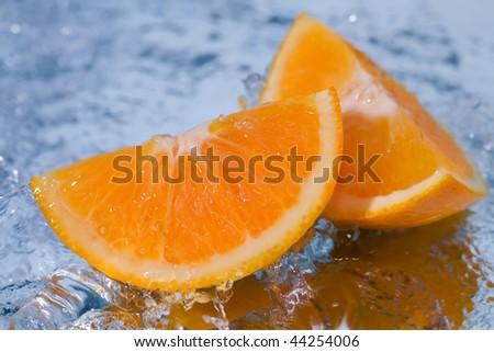Oranges of golden color in sparks of water #44254006