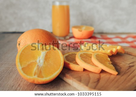 oranges on a cutting board and juice