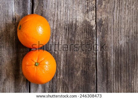 oranges on textured weathered wooden table - top view