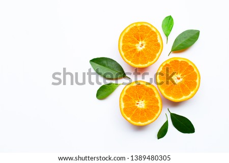 Oranges on white background. Copy space