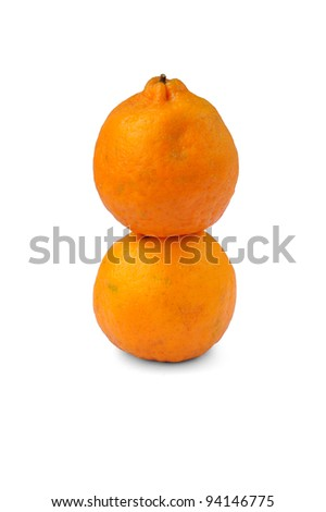 Oranges stacked together in 8 shape (symbolizes good luck) isolated on a white background, selective focus.