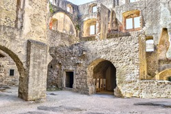 Orava Castle - stone fortress from thirteenth century. Courtyard of a stone castle. Museum of ancient stone fortress. Thick walls, round entrances, window niches.