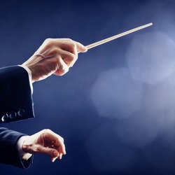 Orchestra conductor hands baton. Music conducting director holding stick