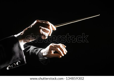 orchestra conductor hands baton....