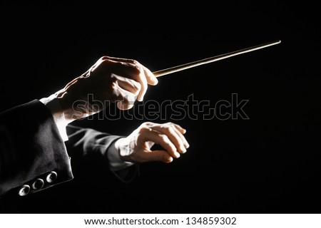 orchestra conductor hands baton....