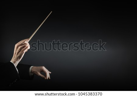 Orchestra conductor music conducting. Hands of conductor with baton. Maestro stick #1045383370