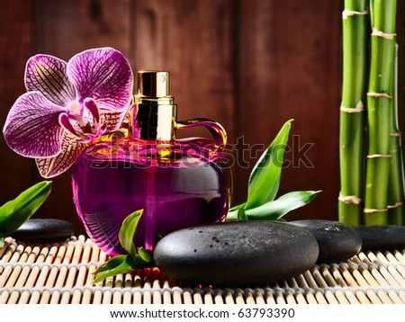 orchid and parfume bottle