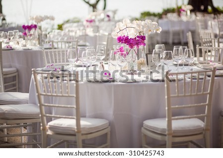 Orchid centerpiece at an outdoor event or wedding reception