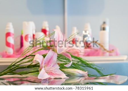 Orchid flowers in the background of the collection of cosmetics