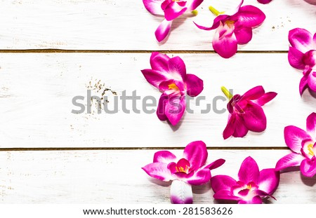 Orchid flowers on a wood background useful as invitation cards and greeting card