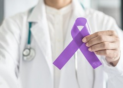 Orchid purple (lavender) ribbon awareness in doctors hand for  (all kinds cancers), Testicular Cancer awareness, Craniosynostosis, Epilepsy, Hodgkin's lymphoma, National Cancer Prevention Month